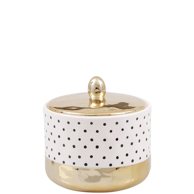 white and golden jar black dots